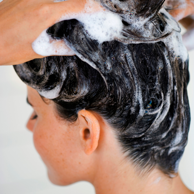 How does over-shampooing your hair contribute toward hair breakage?